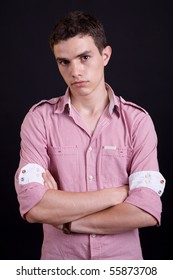 young casual man against a black background