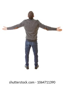 young casual man from the back with arms eide open, full body, isolated