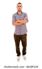 young casual man full body standing with arms crossed against white background