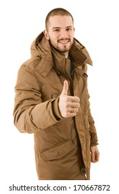 young casual man going thumb up, isolated on white
