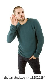 young casual man listening in white background