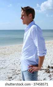 Young casual man relaxing on the beach