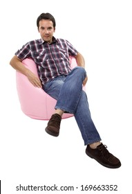 young casual man seated in a small sofa