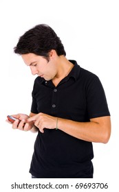 Young casual man using a mobile phone isolated over white