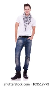 young casual man wearing boots, jeans and scarf looking at the camera on white background