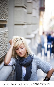 Young casual urban girl with sad expression