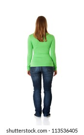 Young casual woman from behind, isolated on white