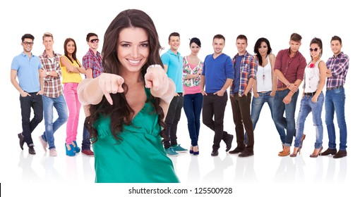young casual woman choosing you for her team by pointing her finger