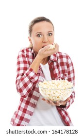 Young casual woman eating popcorn. isolated on white.