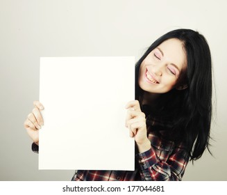 young casual woman happy holding blank sign