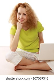 young casual woman sitting down and work on laptop