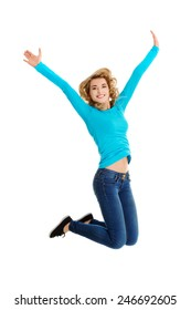 Young casual woman, student jumping in air.