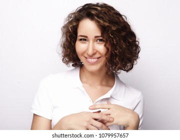 Young casual woman style over white background. studio portrait,