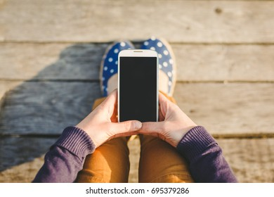 young casual woman using smart phone