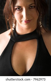 Young Caucasian adult woman in a black evening wear – Hard Light