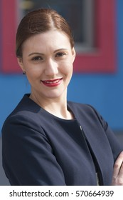 Young caucasian attractive stewardess portrait with smile in blue dress