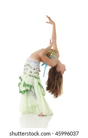 Young Caucasian belly dancing girl in beautiful decorated clothes on white background and reflective floor. Not isolated