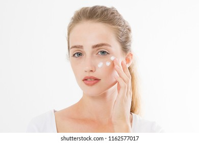 Young caucasian blonde woman and face skin care moisturizing cream on face. Anti aging and spa concept. Make up and nature beauty. Copy space