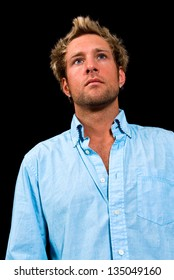 Young, Caucasian, blue eyed, blonde male shot on a black background