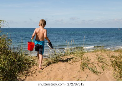 Young caucasian boy in Denmark on a summer day.