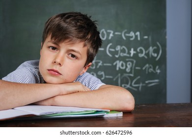 Young caucasian boy is learning in elementary school