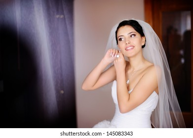 young caucasian brunette bride is getting ready in  the morning