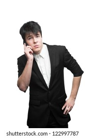 young caucasian brunette businessman isolated on white background talking on cell phone