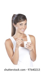 Young caucasian brunette eating yoghurt isolate onwhite