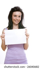 young caucasian brunette holding a blank paper panel.Concept of advertising,free space