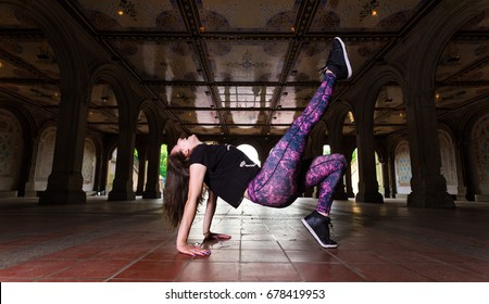 Young Caucasian Brunette Woman Performs Hip Hop Dance Wearing Athleisure Under The Minton Tiles at Bethesda Arcade