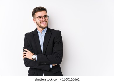Young caucasian business man posing in a white background isolated Young caucasian business man smiling confident with crossed arms.
