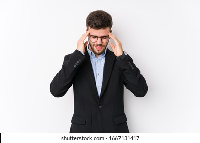 Young caucasian business man posing in a white background isolated Young caucasian business man touching temples and having headache.