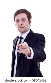 Young caucasian business man in a suit, pointing at camera