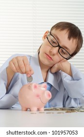Young Caucasian Business a nice guy puts a coin in a piggy bank on white background