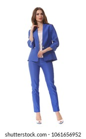young caucasian business woman executive posing in designer formal summer blue pant suit high heels stiletto shoes full body length isolated on white