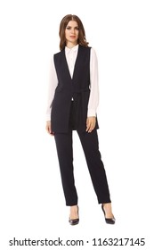 young caucasian business woman executive posing in black vest and official trousers high heels stiletto shoes full body length isolated on white