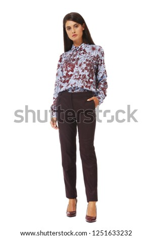 5f6659437d5 young caucasian business woman executive posing in designer formal casual  print blouse and trousers sneakers shoes