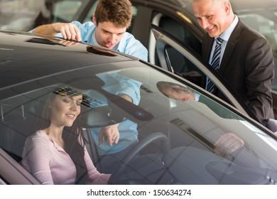 Young Caucasian couple choosing car