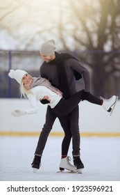 Young Caucasian Couple in Winter With Ice Skates Skating and Posing Together Over a Snowy Winter Landscape Outdoors.  - Shutterstock ID 1923596921