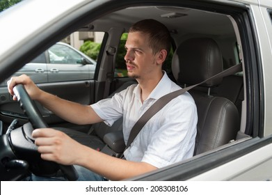 Young caucasian driver goes by rules and safe
