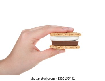 Young caucasian female hand holding s'more, isolated on white background