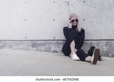 Young Caucasian Female Model in Sunglasses and Fashion Stylist Minimalist Urban Parking Garage