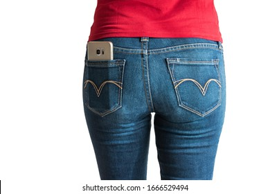 Young Caucasian female red t-shirt modeling smart phone in blue jeans pocket no face isolated on white 2020