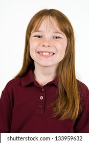 Young Caucasian female in school polo shirt