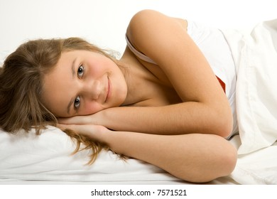 Young caucasian girl in bed