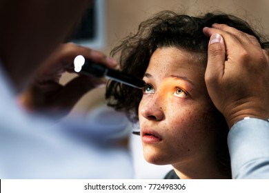Young Caucasian girl getting an eye examination