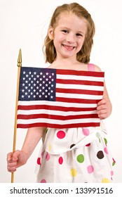 Young caucasian girl holding an American Flag