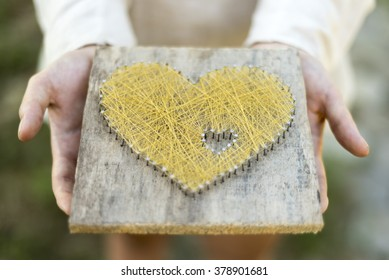Young caucasian girl offering symbolic heart  open palms