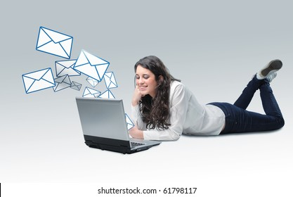 young caucasian girl on floor send email by her laptop