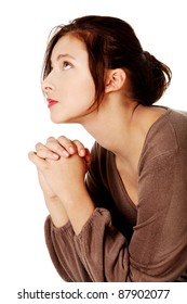 Young caucasian girl praying and looking up. Over white background.
